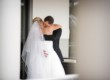 bride and groom embrace outside hotel