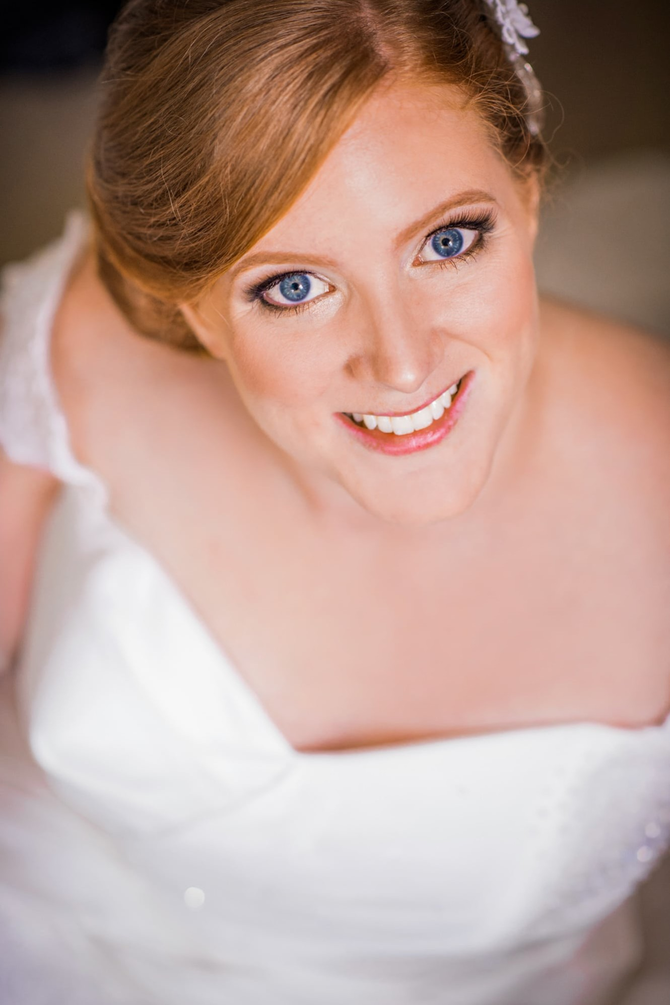 A close up of a red headed bride