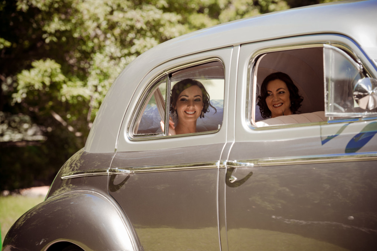 Bride and her mother arrive in the wedding car