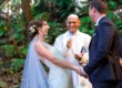 Bride groom and minster smiling at conclusion of wedding ceremony